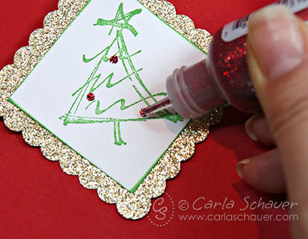 Adding glitter accents to Christmas gift tags by Carla Schauer Designs