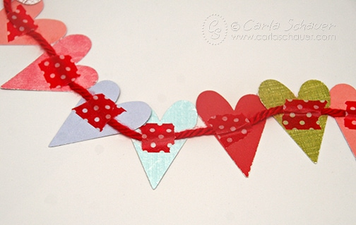 Punched heart banner attached with washi tape.  From Carla Schauer Designs.