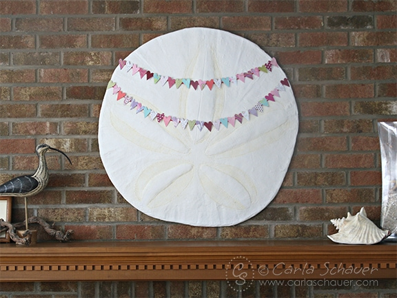 Punched heart valentine banner from scraps.  From Carla Schauer Designs.