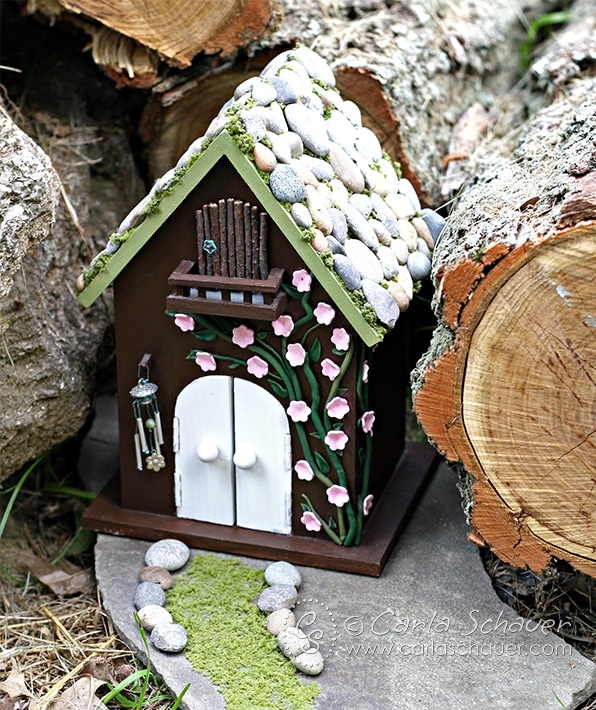 DIY Fairy House with stone roof and clay flowers, from carlaschauer.com