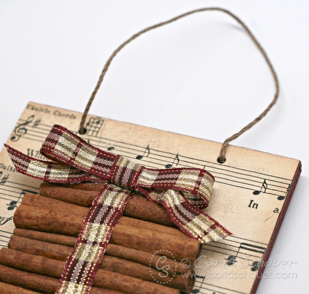 Ornament made with cinnamon sticks and sheet music from carlaschauer.com