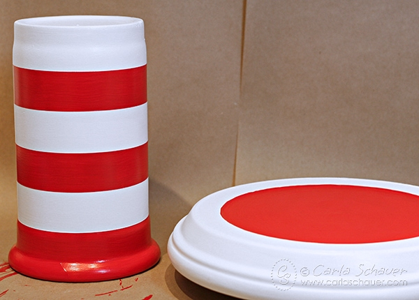 DIY Dr. Seuss painted striped cake stand.  Tutorial from Carla Schauer Designs.