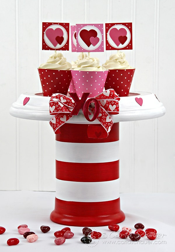 Make a love-themed cake stand for Valentine's Day or anniversaries using acrylic paint and terra cotta flower pots.  Tutorial from Carla Schauer Designs at carlaschauer.com.