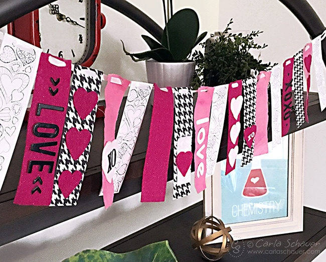 DIY Valentine Garland using printable coloring bookmarks and fabric strips. What a cute use for coloring printables!