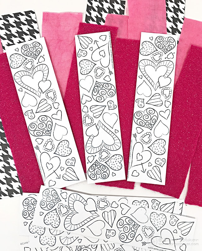 Make a Valentine garland decoration from coloring pages. Cute idea to use all those coloring pages! carlaschauer.com