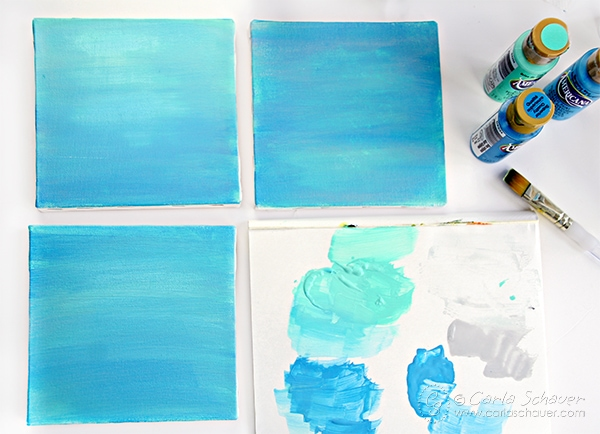 Paint coastal decor canvases using an ombre technique for beachy home decor. Tutorial from Carla Schauer Designs