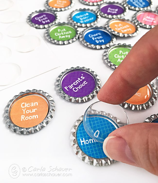 Bottlecaps + free printables + epoxy circles = Family organization. Yay! Finally, a system we can stick with! | carlaschauer.com