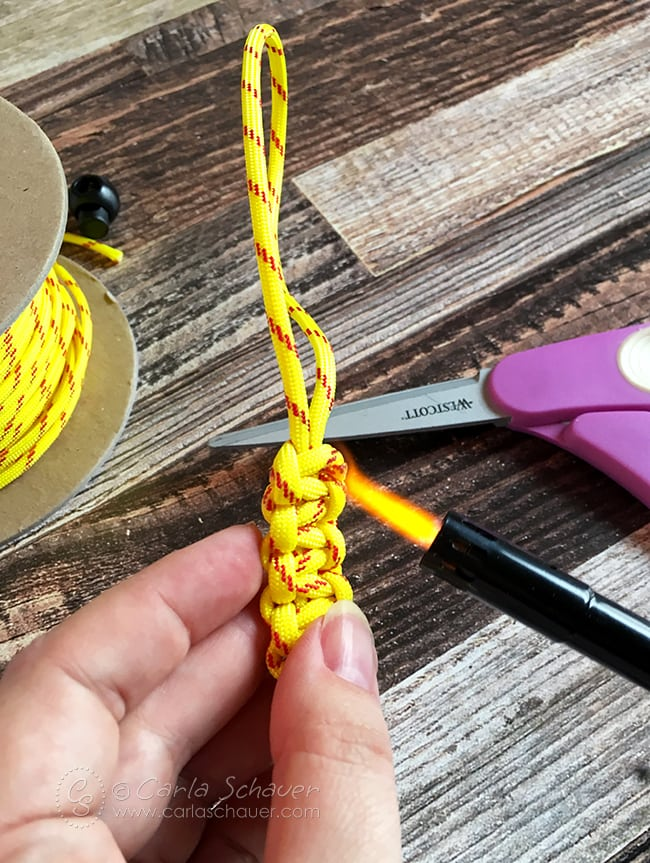 Melt ends of paracord to prevent fraying.